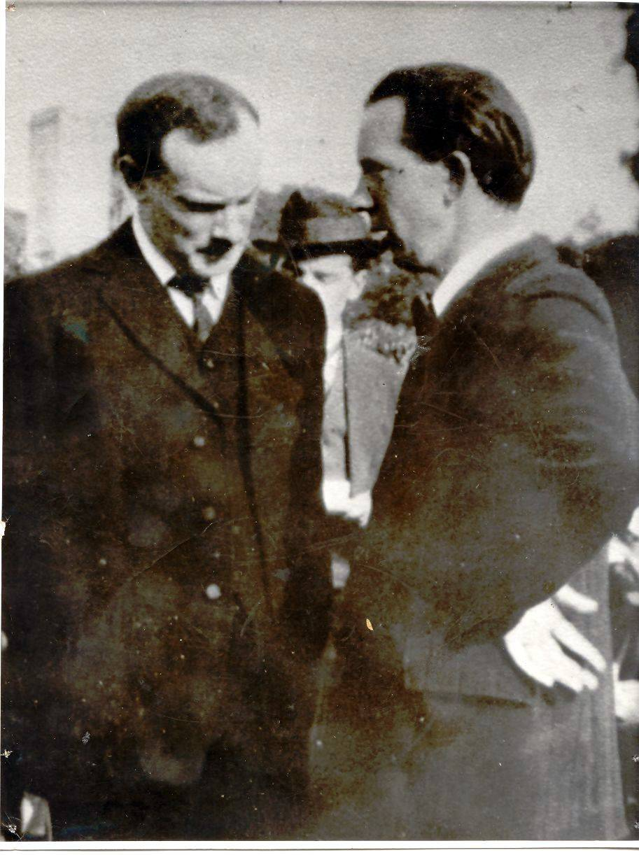 Patrick and William Pearse deep in conversation at a St Enda's event in 1914. The school was under considerable financial strain at this time. OPW.